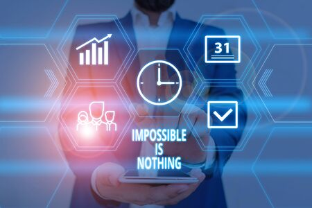 Text sign showing Impossible Is Nothing. Business photo showcasing Anything is Possible Believe the Realm of Possibility Male human wear formal work suit presenting presentation using smart device
