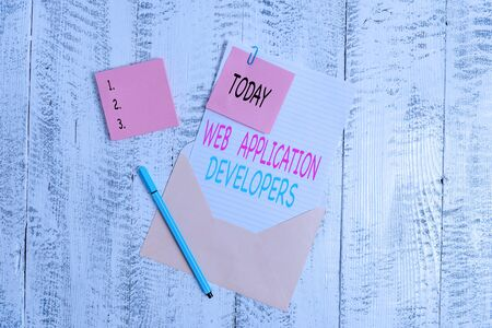 Conceptual hand writing showing Web Application Developers. Concept meaning Internet programming experts Technology software Envelope blank sheet sticky note ballpoint wooden background Stok Fotoğraf