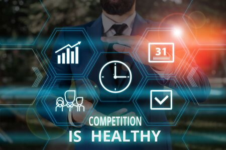 Word writing text Competition Is Healthy. Business photo showcasing Rivalry is good in any Venture leads to Improvement Male human wear formal work suit presenting presentation using smart device