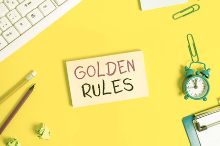 Handwriting text Golden Rules. Conceptual photo basic principle that should always follow to ensure success Flat lay above copy space on the white crumpled paper Standard-Bild