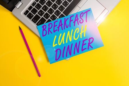 Conceptual hand writing showing Breakfast Lunch Dinner. Concept meaning eating your meals at different period of day Metallic laptop small paper sheet pencil colored background Stock fotó