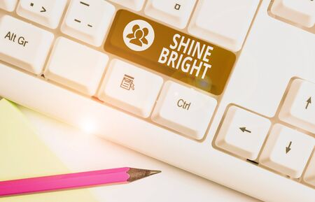 Word writing text Shine Bright. Business photo showcasing make an effort to live normally when in a difficult situation White pc keyboard with empty note paper above white background key copy space 스톡 콘텐츠