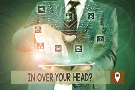 Handwriting text writing In Over Your Head Question. Conceptual photo To be involved in a difficult situation problem Male human wear formal work suit presenting presentation using smart device