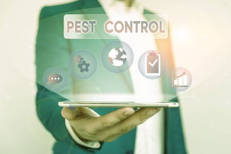 Writing note showing Pest Control. Business concept for analysisagement of a species that impacts adversely on huanalysis Male human wear formal suit presenting using smart device 写真素材