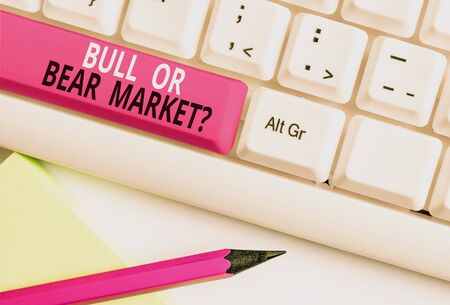 Conceptual hand writing showing Bull Or Bear Market Question. Concept meaning asking someone about his marketing method White pc keyboard with note paper above the white background