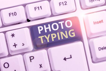 Conceptual hand writing showing Photo Typing. Concept meaning metal printing block use to reproduce a photograph in printing White pc keyboard with note paper above the white background