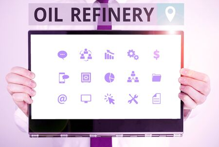 Word writing text Oil Refinery. Business photo showcasing industrial process of converting crude oil into petroleum Male human holding thick textured cardboard of business promotion concept