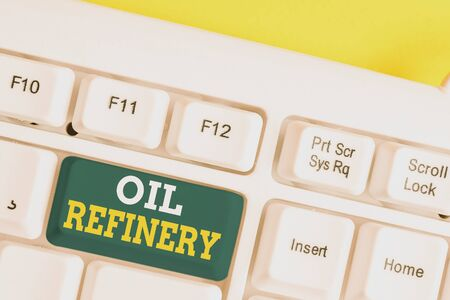 Word writing text Oil Refinery. Business photo showcasing industrial process of converting crude oil into petroleum White pc keyboard with empty note paper above white background key copy space