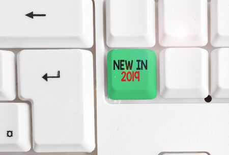 Word writing text New In 2019. Business photo showcasing what will be expecting or new creation for the year 2019 White pc keyboard with empty note paper above white background key copy space 版權商用圖片