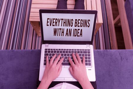 Writing note showing Everything Begins With An Idea. Business concept for steps you take to turn an idea into a reality woman laptop computer office supplies technological devices inside home