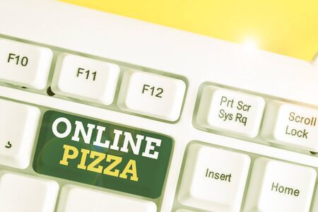 Word writing text Online Pizza. Business photo showcasing fast delivery of pizza at your doorstep Ordering food online White pc keyboard with empty note paper above white background key copy space