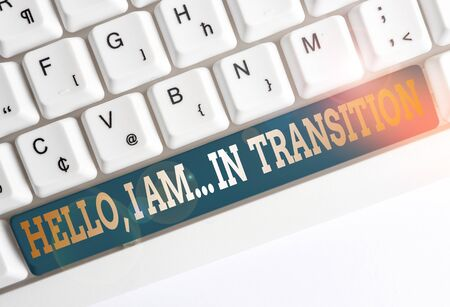Text sign showing Hello I Am In Transition. Business photo text Changing process Progressing planning new things White pc keyboard with empty note paper above white background key copy space