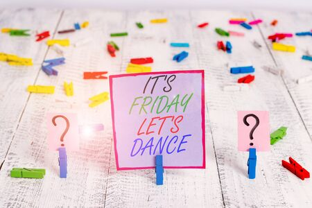 Handwriting text writing It S Friday Let S Dance. Conceptual photo Celebrate starting the weekend Go party Disco Music Scribbled and crumbling sheet with paper clips placed on the wooden table