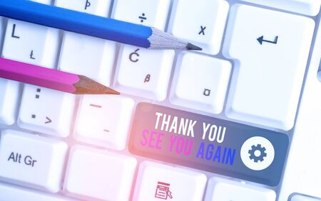 Handwriting text writing Thank You See You Again. Conceptual photo Appreciation Gratitude Thanks I will be back soon White pc keyboard with empty note paper above white background key copy space