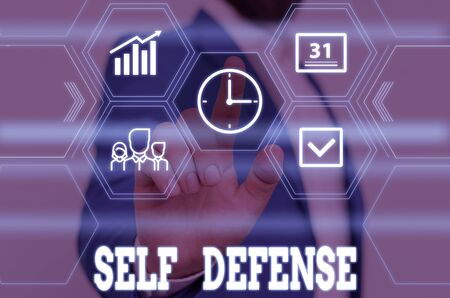 Writing note showing Self Defense. Business concept for the act of defending one s is demonstrating when physically attacked Male wear formal work suit presenting presentation smart device Stock fotó