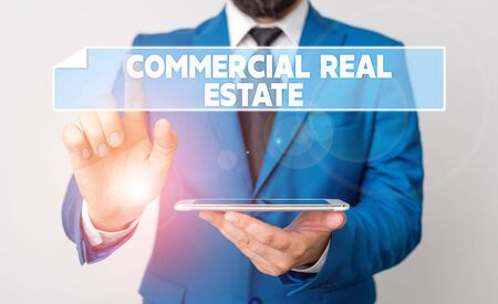 Handwriting text Commercial Real Estate. Conceptual photo Income Property Building or Land for Business Purpose Businessman with pointing finger in front of him
