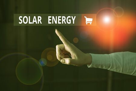 Word writing text Solar Energy. Business photo showcasing radiation from the Sun capable of producing heat or electricity Finger pointing in the Dark with hand pointing in the copy space