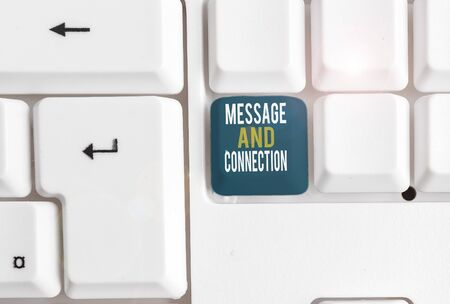 Conceptual hand writing showing Message And Connection. Concept meaning a word or letter sent to someone and it was received White pc keyboard with note paper above the white background