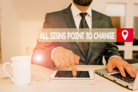 Writing note showing All Signs Point To Change. Business concept for Necessity of doing things differently new vision