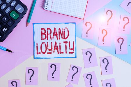 Writing note showing Brand Loyalty. Business concept for Repeat Purchase Ambassador Patronage Favorite Trusted Mathematics stuff and writing equipment above pastel colours background Stock Photo