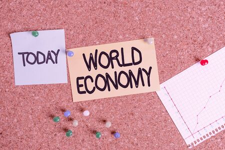 Handwriting text writing World Economy. Conceptual photo Global Worldwide International markets trade money exchange Corkboard color size paper pin thumbtack tack sheet billboard notice board Stock Photo