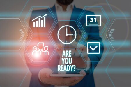 Text sign showing Are You Ready Question. Business photo showcasing Setting oneself on the activity Being Prepared Male human wear formal work suit presenting presentation using smart device
