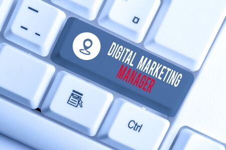 Conceptual hand writing showing Digital Marketing Manager. Concept meaning optimized for posting in online boards or careers White pc keyboard with note paper above the white background