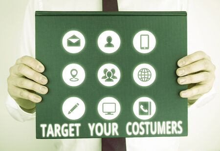 Handwriting text writing Target Your Costumers. Conceptual photo Specific Range and Interest Potential Users and Buyers Male human holding thick textured cardboard of business promotion concept 版權商用圖片