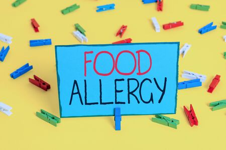 Text sign showing Food Allergy. Business photo showcasing an abnormal immune response after eating a certain food Colored clothespin papers empty reminder yellow floor background office 版權商用圖片