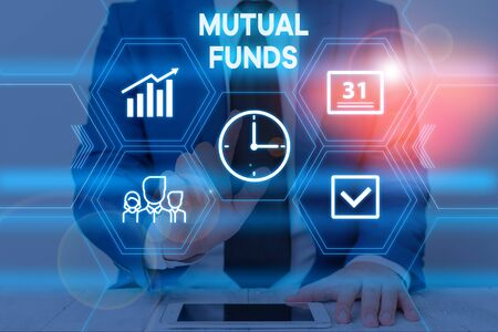 Text sign showing Mutual Funds. Business photo text collection of stocks bonds or other securities from investors Male human wear formal work suit presenting presentation using smart device Stock Photo