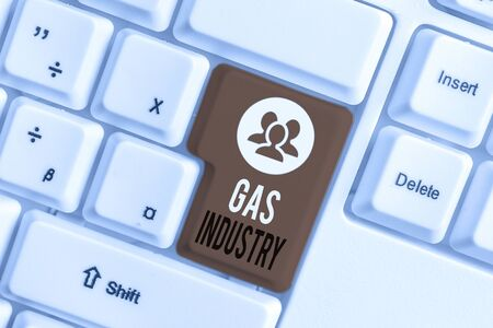 Handwriting text writing Gas Industry. Conceptual photo global processes exploration and selling of petroleum products White pc keyboard with empty note paper above white background key copy space