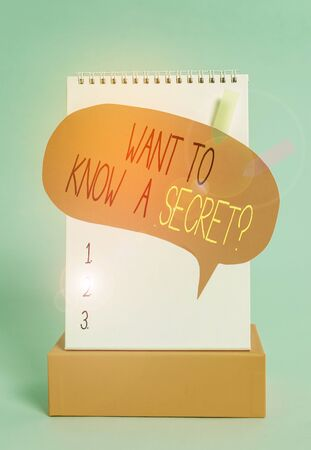 Writing note showing Want To Know A Secret Question. Business concept for to divulge a confidential vital information Spiral notepad box speech bubble arrow banners cool colored background