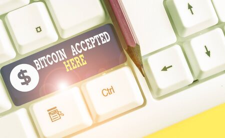 Word writing text Bitcoin Accepted Here. Business photo showcasing you can purchase things through Cryptocurrencies White pc keyboard with empty note paper above white background key copy space 版權商用圖片