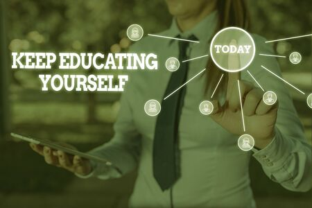Writing note showing Keep Educating Yourself. Business concept for dont stop studying Improve yourself using Courses Woman wear formal work suit presenting presentation using smart device