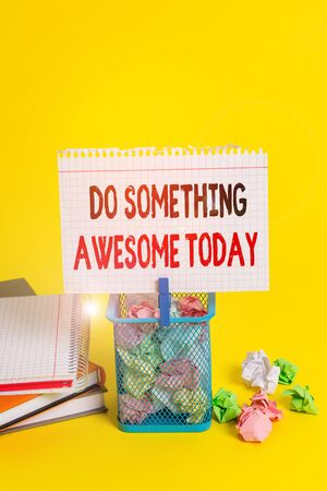 Handwriting text Do Something Awesome Today. Conceptual photo Make an incredible action motivate yourself Trash bin crumpled paper clothespin empty reminder office supplies yellow