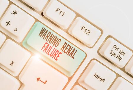 Handwriting text writing Warning Renal Failure. Conceptual photo stop Filtering Excess Waste Acute Kidney malfunction White pc keyboard with empty note paper above white background key copy space