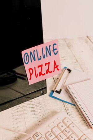 Writing note showing Online Pizza. Business concept for fast delivery of pizza at your doorstep Ordering food online Note paper taped to black computer screen near keyboard and stationary