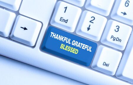 Handwriting text Thankful Grateful Blessed. Conceptual photo Appreciation gratitude good mood attitude White pc keyboard with empty note paper above white background key copy space Banco de Imagens