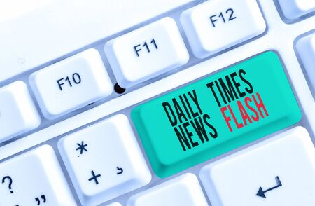 Text sign showing Daily Times News Flash. Business photo text fast response to actions happened in article way White pc keyboard with empty note paper above white background key copy space