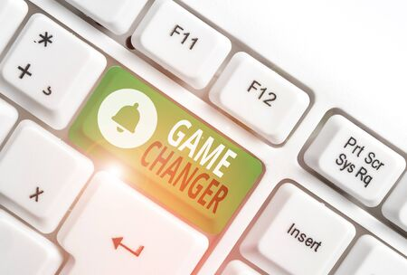 Conceptual hand writing showing Game Changer. Concept meaning way that effects a major shift in the current analysisner of doing White pc keyboard with note paper above the white background Stock Photo