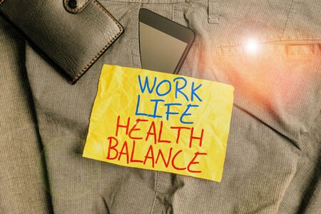 Writing note showing Work Life Health Balance. Business concept for Stability and Harmony to prevent burnt out Smartphone device inside trousers front pocket with wallet