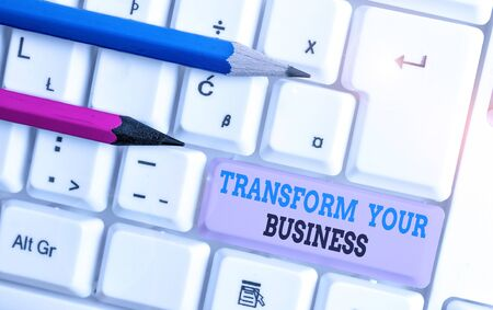 Handwriting text Transform Your Business. Conceptual photo Modify energy on innovation and sustainable growth White pc keyboard with empty note paper above white background key copy space 스톡 콘텐츠