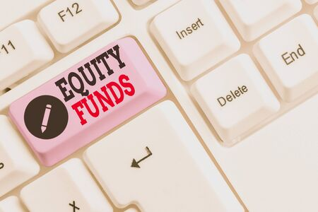 Text sign showing Equity Funds. Business photo text type of mutual fund that buys ownership in businesses White pc keyboard with empty note paper above white background key copy space