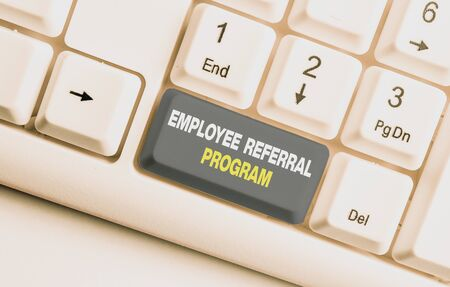 Handwriting text Employee Referral Program. Conceptual photo employees recommend qualified friends relatives White pc keyboard with empty note paper above white background key copy space