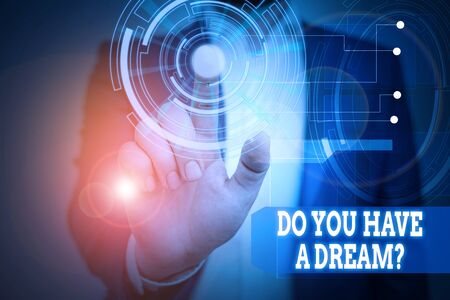 Text sign showing Do You Have A Dream Question. Business photo text asking someone about life goals Achievements Male human wear formal work suit presenting presentation using smart device