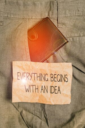 Word writing text Everything Begins With An Idea. Business photo showcasing steps you take to turn an idea into a reality Small little wallet inside man trousers front pocket near notation paper Stockfoto