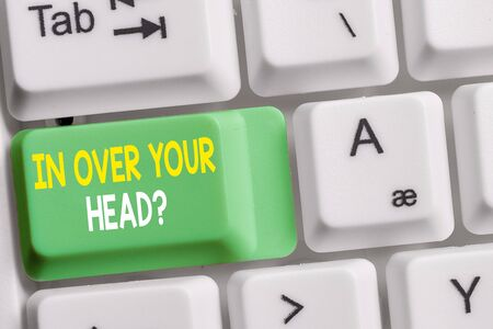 Text sign showing In Over Your Head Question. Business photo showcasing To be involved in a difficult situation problem White pc keyboard with empty note paper above white background key copy space