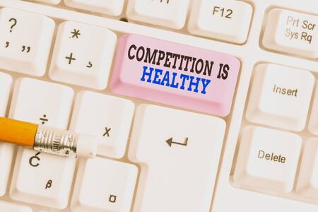 Word writing text Competition Is Healthy. Business photo showcasing Rivalry is good in any Venture leads to Improvement White pc keyboard with empty note paper above white background key copy space Banco de Imagens