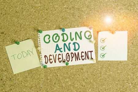 Handwriting text Coding And Development. Conceptual photo Programming Building simple assembly Programs Corkboard color size paper pin thumbtack tack sheet billboard notice board