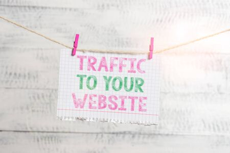 Writing note showing Traffic To Your Website. Business concept for Lifeblood of online business more Potential Leads Clothesline clothespin rectangle shaped paper reminder white wood desk
